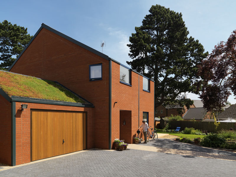 Front exterior view with sedum room on garage