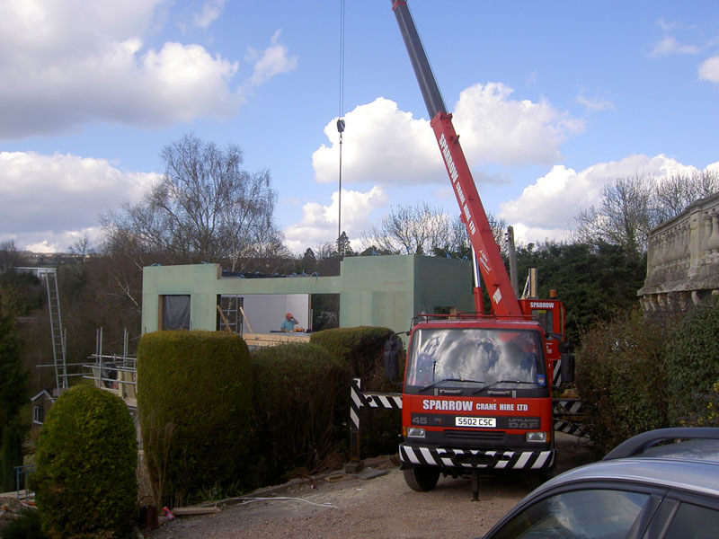 Timber frame craned into place